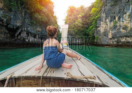 Traveler concept - Beautiful woman traveling on long boat to Hong Islands in andaman sea Krabi South of Thailand.