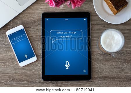 computer PC tablet and touch phone with app personal assistant screen on table