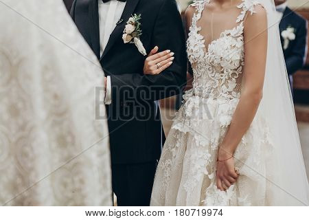 Luxury Wedding Couple Hugging, Holding Hands During Traditional Wedding Ceremony In Church. Priest B