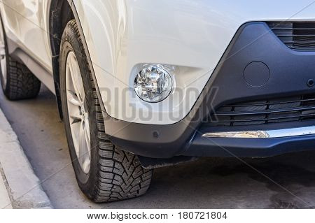 Closeup photograph of anti-fog headlights of moderm new car.