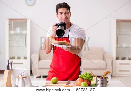 Food photographer taking photos in kitchen