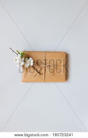 Cute Gift Box Wrapped With Craft Paper And Flowers Top View