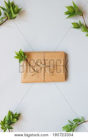 Cute Gift Box Wrapped With Craft Paper And Leaves Top View