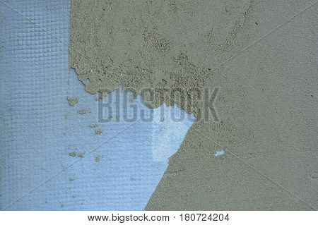 Abstract texture of wall covered with obsolete blue cement plaster