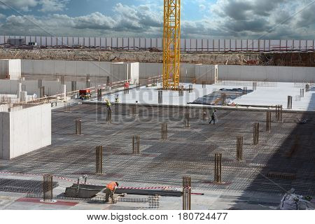 Workers making industrial framework for concrete floor