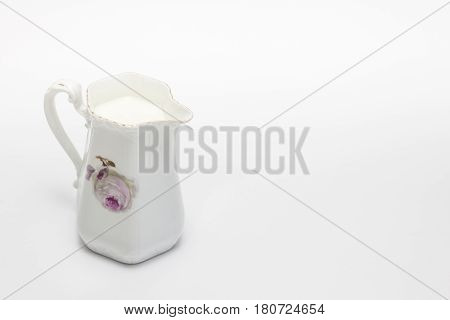 White old grandma's pitcher full of milk