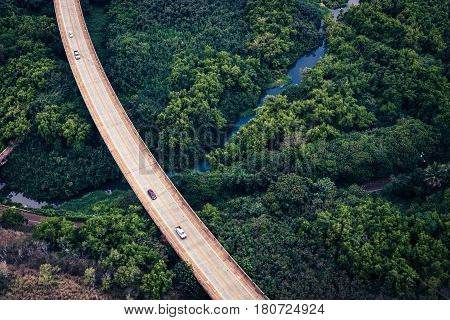 Aerial view of the road in lush green forest Kauai Hawaii USA