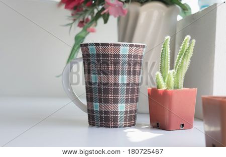 Mug Of Coffee On Table In The Coffee Shop With Flower.