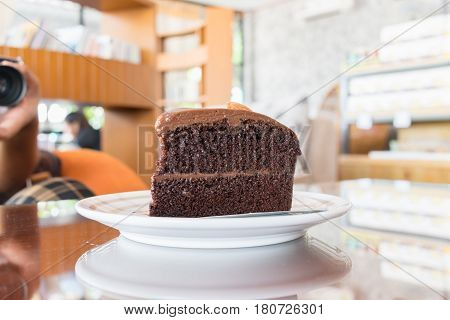 Double Chocolate Cake On The Table In Cafe, Coffee Time Concept.