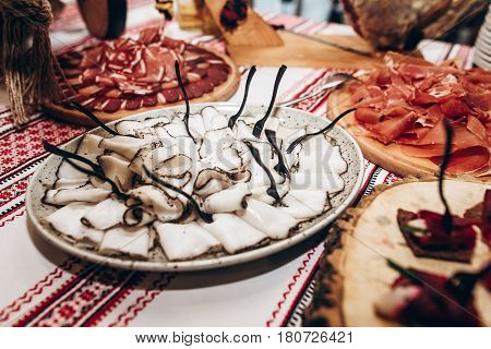 Lard On Table At Luxury Wedding Reception. Ham,bacon,sausages,salami,prosciutto,lard On Wooden Desk.