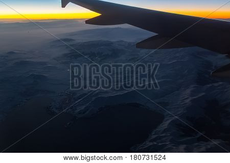 Aerial View From Airplane Window At Sunset