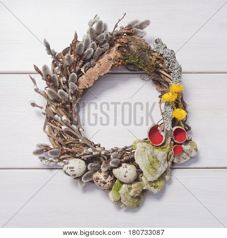 Spring Wreath On A White Wooden Background