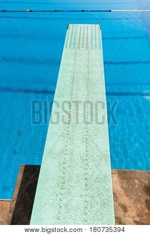 Diving board swimming pool aquatic sport outdoors.