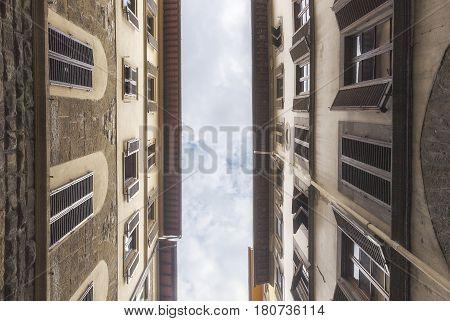 Florentine windows in a narrow street travel