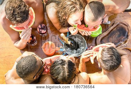 Top view of multiracial friend having fun at sail boat party with sangria watermelon champagne - Friendship concept with young multi racial people on sailboat - Travel lifestyle on exclusive vibe mood