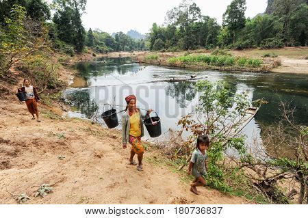 Women Carrying Buckets Of Water From The River