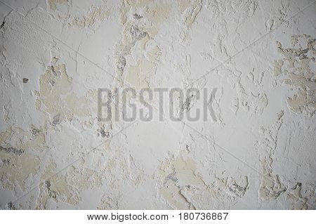 The texture, the creamy wall, it is marked by white smears of putty.Close