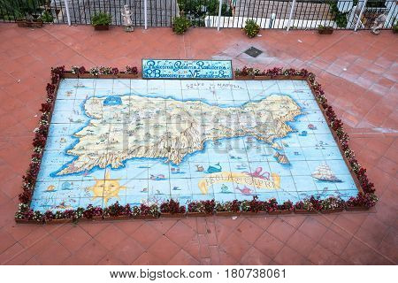 Capri Italy - August 31 2016: Map of Capri painted on a glazed tiles in traditional style.