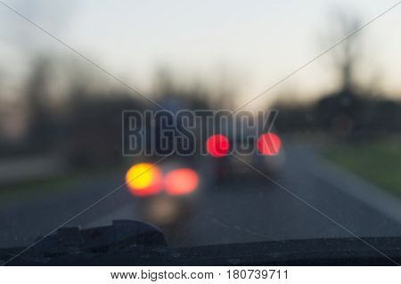 motorcycle overtakes car in a blurred composition with bokeh light at night hours