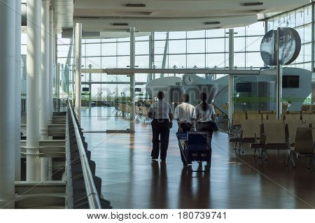 Madrid Spain: 24th July 2016: Airport staff is preparing for next fly. The Madrid-Barajas Airport is Spain's largest and busiest airport characterised by a floating roof propped by an internal coloured structure.