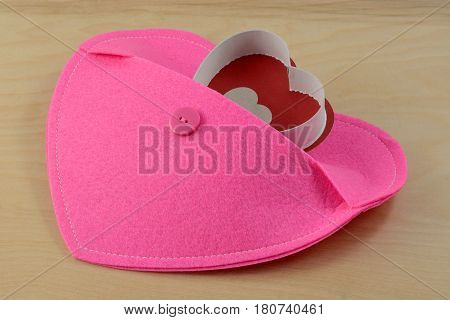 Heart emerging from pocket of larger pink heart