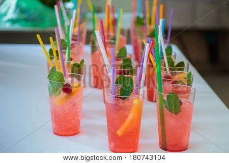 Non-alcoholic cocktails. Fruit and berry cocktails with colored tubules. Fitness Bar