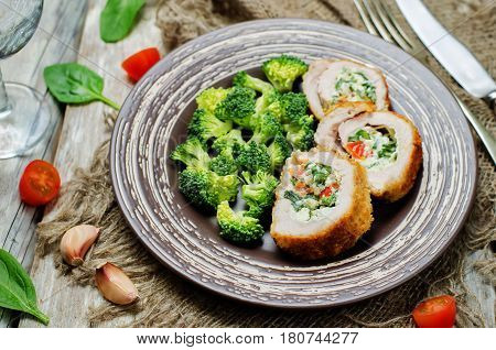 Ricotta tomato spinach stuffed turkey with broccoli.