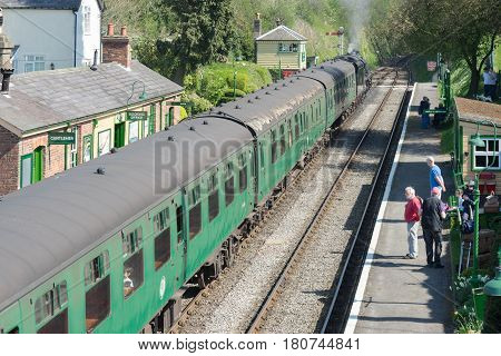 Medstead, UK. 8th April 2017. A steam train is pulling in to the platform at Medstead station on the Watercress Heritage railway line on a sunny spring day.
