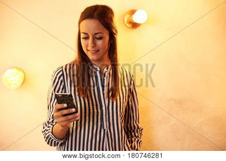 Happy Millennial Reading Message While Smiling
