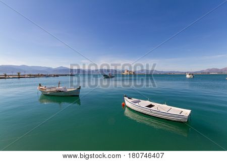 Fishing Boats, Lightouse And Bourtzi Fortress In Nafplion, Greece- Wide-angle Photo