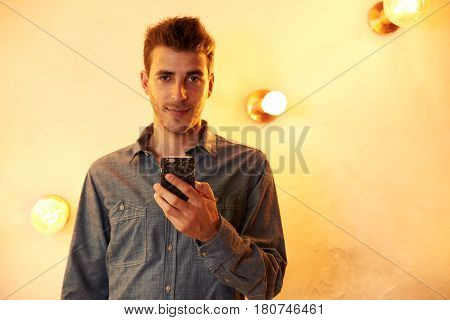Cute Young Man Posing With Cellphone