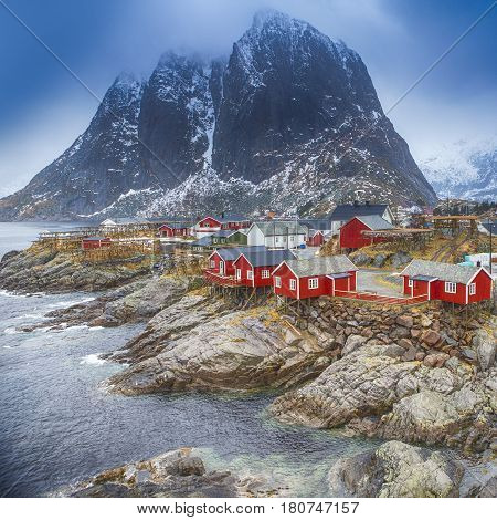 Travel Concepts and Ideas. Traditional Fishing Hut Village in Hamnoy Mountain Peak in Lofoten Islands Norway. Square Image Composition