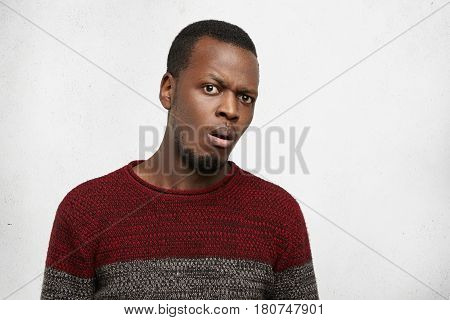 Human Emotions And Feelings. Headshot Of Bearded Young Dark-skinned Male Dressed In Jersey Sweater F