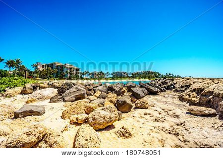 The rocky shoreline of the west coats of the island of Oahu at the resort area of Ko Olina in the island state of Hawaii in the Pacific Ocean