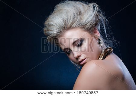 Beautiful Blond Female Fashion Model Photographed In A Dark Studio