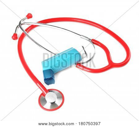 Asthma inhaler and stethoscope on white background