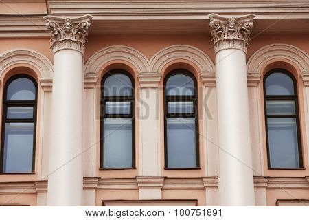Arched windows with decorated wall background
