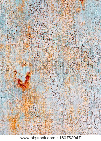 Abstract blue orange texture with grunge cracks. Cracked paint on a metal surface. Bright urban background with rough paint transitions. The cracks grunge urban background. Abstract painted watercolor texture with slits and cracks