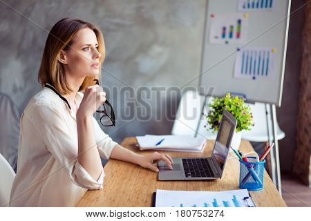 Young Cute Woman With Glasses Dreaming And Resting While Sitting At Table In Workplase