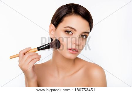 Portrait Of Young Beautiful Woman Holding The Makeup Brush
