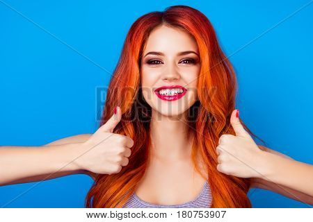 Close-up Portrait Of  Cute Attractive Excited Girl With Long Ginger Fair Hair Gesturing Thumbs Up Si