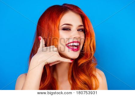 Close-up Portrait Of  Funny Attractive Pretty Girl With Long Ginger Fair Hair Show Gesture Call Me B