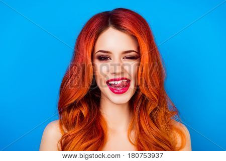 Close Up Portrait Of  Funny Attractive Pretty Girl With Long Ginger Fair Hair Put Out Her Tongue Whi