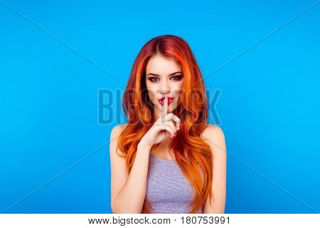 Pretty Charming Young  Woman Having Secret While Holding Finger On Lips And Showing Silence Sign Whi