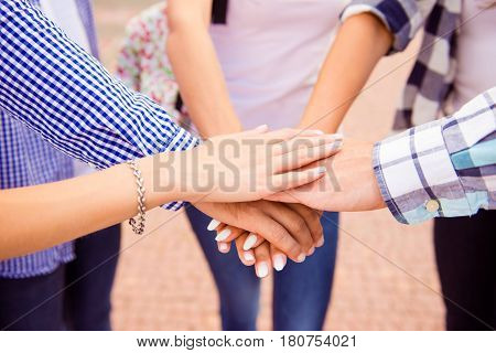 Close Up Photo Of Group Of Teenage Boys And Girls Keeping Hands Together