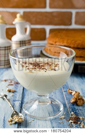 Yogurt cream for cake with chocolate and nut crumbs. Selective focus