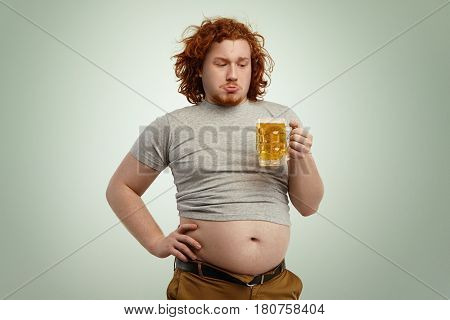 People, Unhealthy Lifestyle, Obesity And Gluttony. Overweight Fat Young European Man With Curly Red