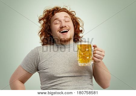 Funny Young Caucasian Male Feeling Happy And Relaxed, Anticipating Fresh Cold Beer In His Hands Afte