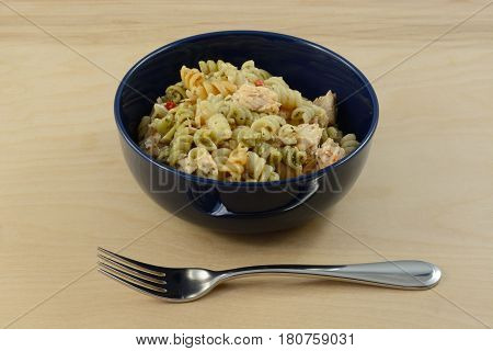 Salmon fillet pasta salad with rotini vegetable pasta in bowl