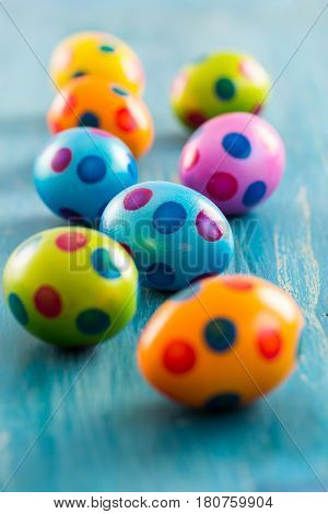 Colorfu Easter eggs on wooden table